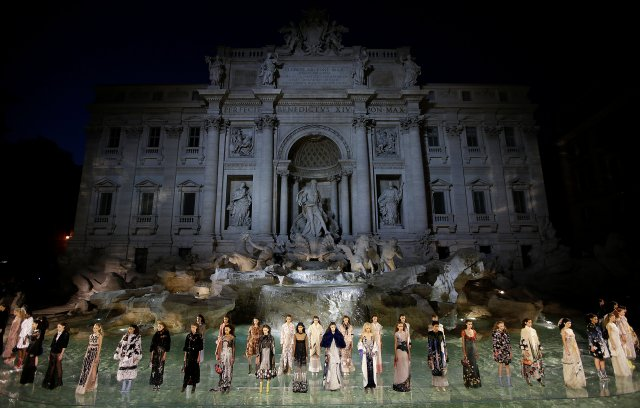 Models present creations to celebrate the 90th anniversary of Fendi Fashion house during a show in Rome